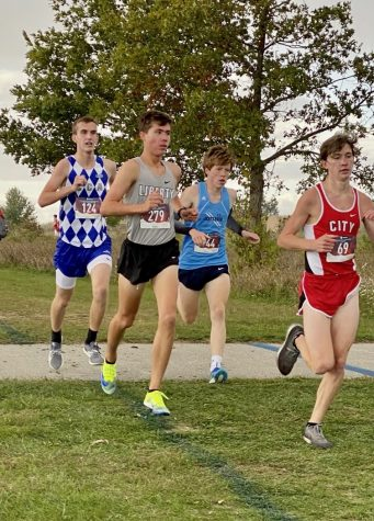 Barker (far left) participating in a Cross Country meet for CCA.